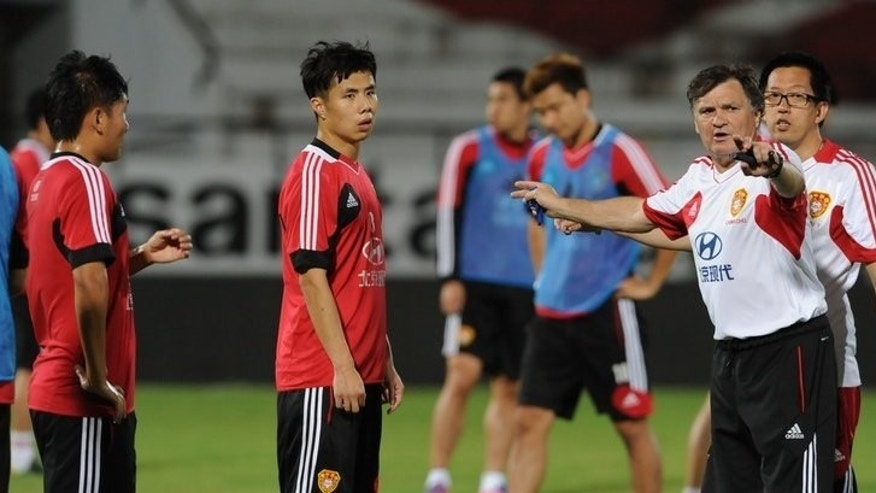Former China football coach Jose Antonio Camacho (R) pictured during a training session in Brazil on September 9, 2012. China is set to spend millions to replace sacked Camacho, but pundits say the team will remain underachievers while business titans run the top clubs.