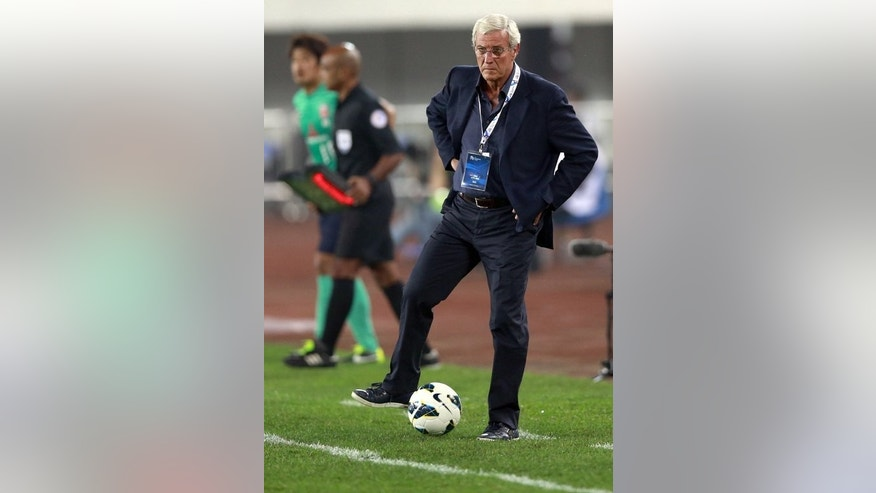 Guangzhou Evergrande coach Marcello Lippi pictured during an AFC Champions League match in China on February 26, 2013. Lippi is the favourite to succeed Jose Antonio Camacho, but Guangzhou Evergrande are expected to demand millions in compensation to release him.