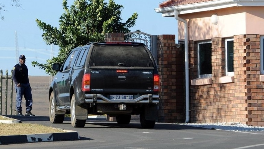 A car carrying elders from the Mandela family is seen outside the former state president's home in Qunu on June 25, 2013. A South African court has ordered the return of the remains of three of Nelson Mandela's children to his ancestral village, following a bitter family feud linked to the eventual burial site of the ailing anti-apartheid hero.