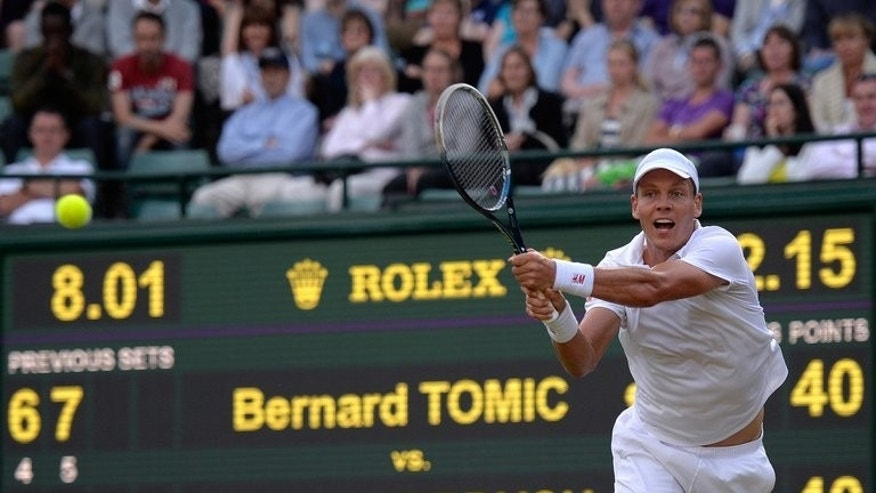 "Tomas Berdych returns against Bernard Tomic during their Wimbledon match on July 1, 2013. ""It's the quarter-finals of a Grand Slam. He's an established top 5, top 10 player in the world,"" Novak Djokovic said of Berdych."