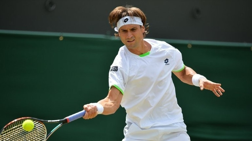 David Ferrer returns against Ivan Dodig during their Wimbledon match on July 1, 2013. Ferrer is in the quarter-finals for the second successive year and faces Argentine eighth seed Juan Martin del Potro.