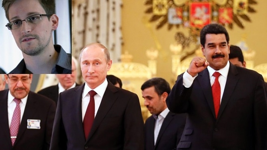Edward Snowden pictured left, Russian President Vladimir Putin, second left, front, and Venezuelan President Nicolas Maduro, right, Iranian President Mahmoud Ahmadinejad, center rear, pose for a photo at the Gas Exporting Countries Forum (GECF) in the Andrew (Throne) Hall in the Grand Kremlin Palace in Moscow, Monday, July 1, 2013.  (AP Photo/Yuri Kochetkov, Pool)