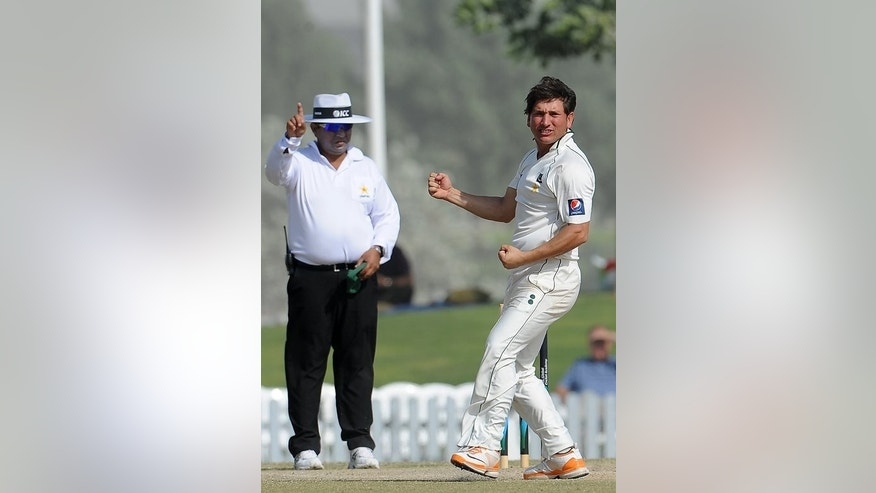 "Pakistani cricketer Yasir Shah (R) celebrates during a practice match against England in Dubai on January 13, 2012. ""(Fawad) Ahmed's height is his advantage and he can baffle England batsmen in the Ashes,"" said Shah."