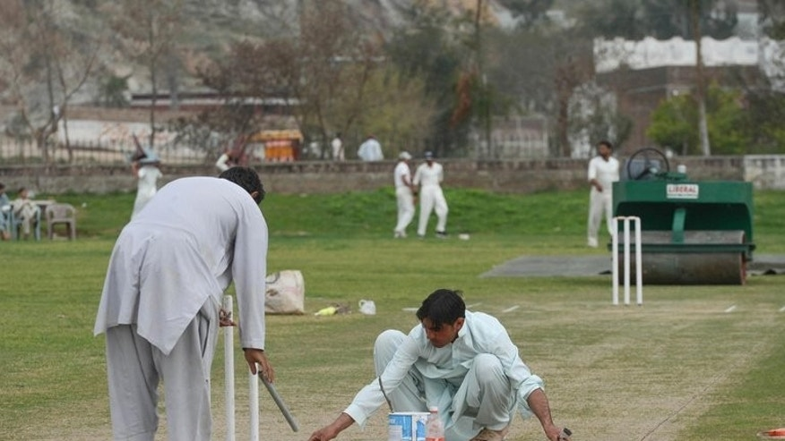 Ground staff prepare a pitch in northwest Swabi, the hometown of a Pakistani cricketer Fawad Ahmed, on March 9, 2013. Swabi is a small town in Pakistan's troubled Khyber Pakhtunkhwa province, hit frequently by Taliban attacks.