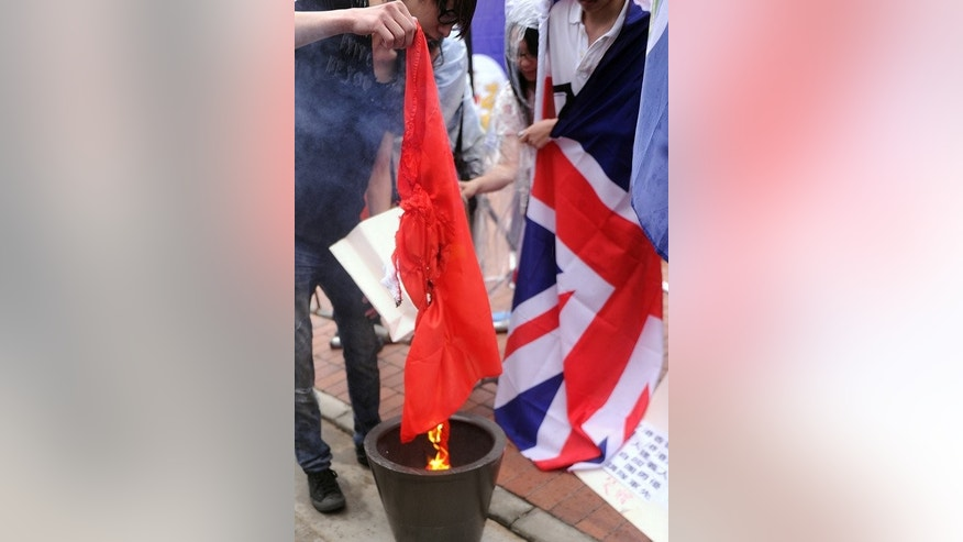 An anti-China protester burns a flag during a rally for democracy in Hong Kong on July 1, 2013. A survey by the Hong Kong University found only 33 percent of Hong Kongers took pride in being a Chinese national, the lowest level since 1998.