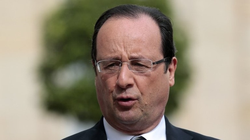 French President Francois Hollande addresses journalists on July 2, 2013 at the Elysee palace in Paris. Hollande on Tuesday called for the European Union to take a common stand over allegations of Washington spying on its allies.