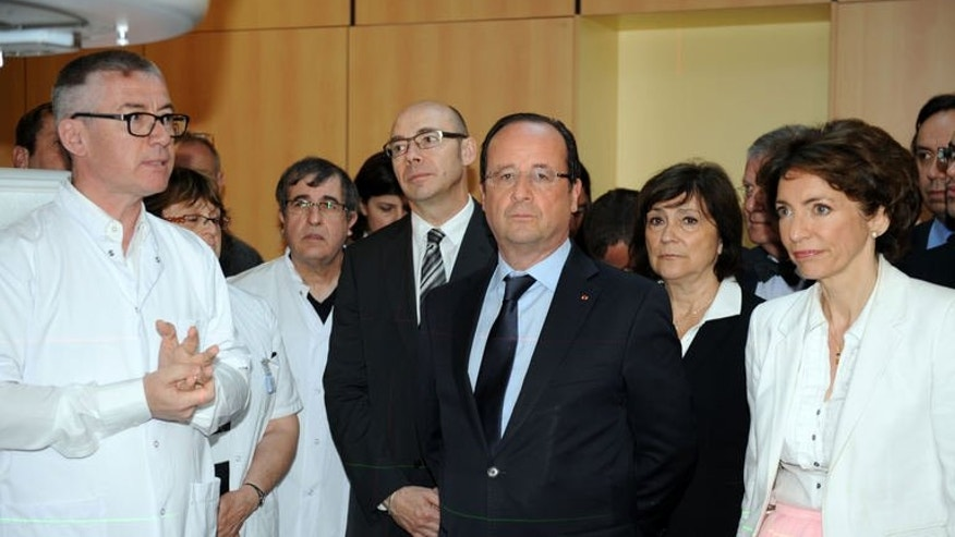 French President Francois Hollande (centre) visits the Bretagne Sud hospital in Brest, western France, on July 1, 2013. Hollande has warned Washington that allegations of its spying on its allies threaten talks on a crucial free trade pact, despite US efforts to play down the row.