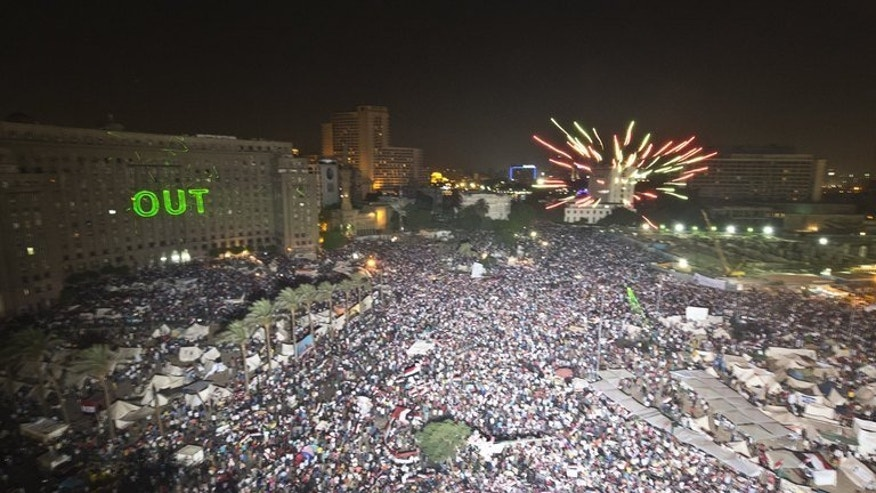 Protesters mass to demand the removal of Egyptian President Mohamed Morsi, in Cairo's Tahrir Square, on July 2, 2013. Unidentified gunmen killed 16 people and wounded 200 others when they opened fire at a Cairo rally supporting embattled Morsi, health ministry officials said Wednesday.