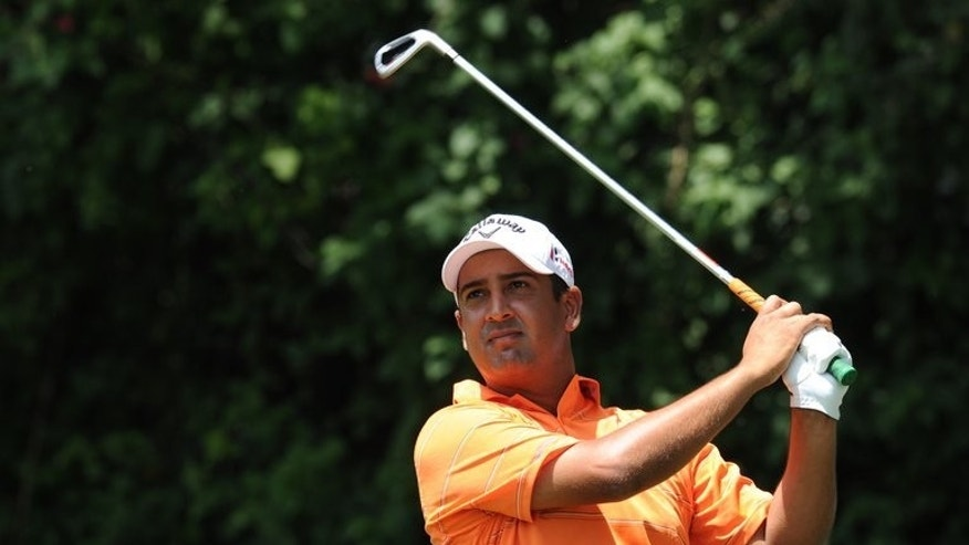 Shiv Kapur of India plays a shot during the Panasonic Open India at the Delhi Golf Club in New Delhi on April 7, 2013. Kapur battled miserable cold and wet conditions in Dunbar on Tuesday to qualify for the British Open later this month at Muirfield.