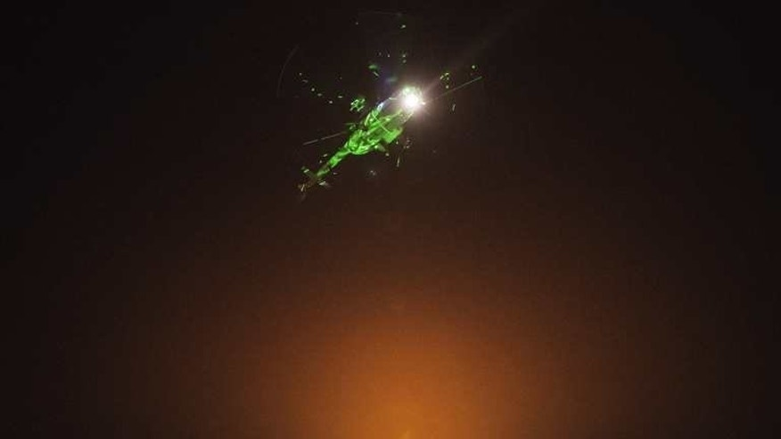 "Egyptian protesters direct laser lights on a military helicopter flying over the presidential palace in Cairo, on July 1, 2013. Iran on Tuesday called on the Egyptian military to support national reconciliation and respect the ""vote of the people"" after it warned it was ready to intervene in Egypt's political crisis."