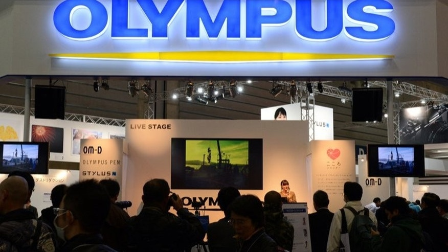An Olympus booth at a photo-imaging show in Yokohama on January 31, 2013. A Japanese court on Wednesday is due to deliver a verdict in the case of three disgraced Olympus executives accused of engineering a massive accounting fraud at the camera and medical equipment maker.