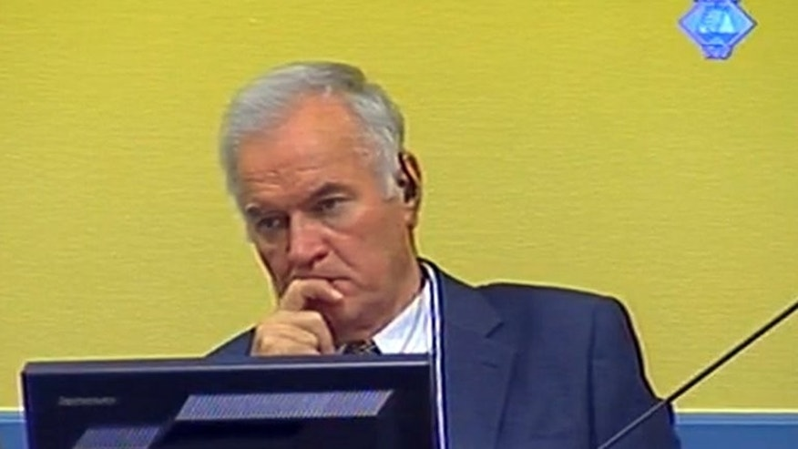 Bosnian Serb ex-army chief Ratko Mladic listens to the first prosecution witness at the International Criminal Tribunal for the former Yugoslavia on July 9, 2012 in The Hague. The International Criminal Tribunal for the former Yugoslavia (ICTY), which saw some of its powers transferred to a new body in The Hague on Monday, has come under fire for a series of recent acquittals.