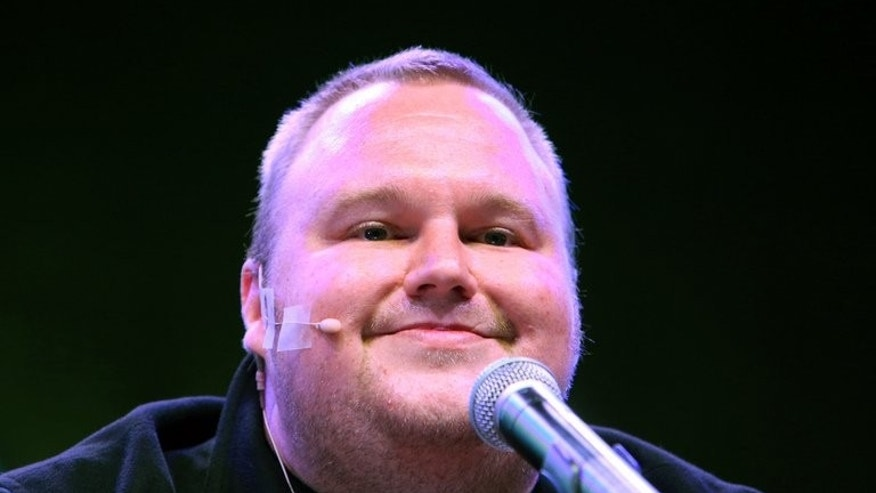 Megaupload founder Kim Dotcom during the launch of his new website on January 20, 2013. He and New Zealand Prime Minister John Key are set to come face to face for the first time Wednesday as lawmakers examine a controversial proposal allowing intelligence agencies to spy on local residents.