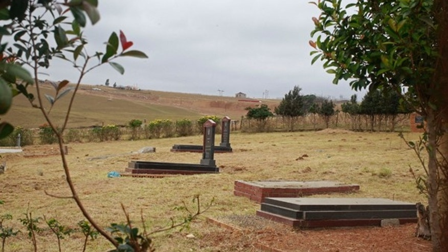 July 1, 2013: The Mandela family grave, right, where the remains of three family members of former South African president Nelson Mandela was previously were removed by his grandson in  Qunu, South Africa.