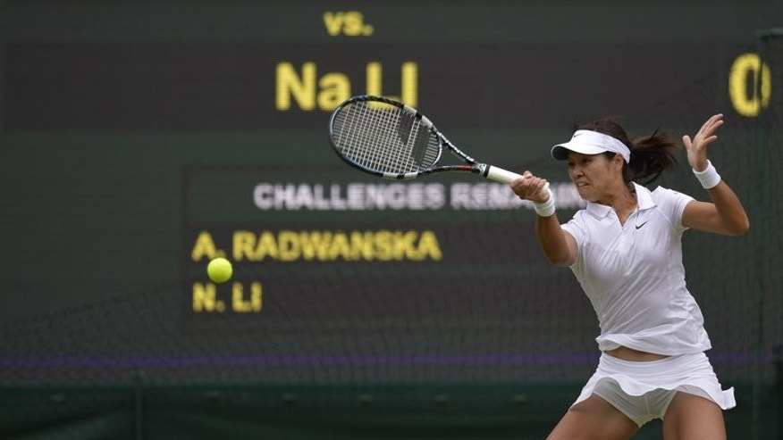 Li Na returns against Agnieszka Radwanska during their Wimbledon women's singles quarter-final match on July 2, 2013. Li confessed she is a convert to serve-and-volley tennis and has vowed to take her new-found skills at the net with her into the US hard court season.