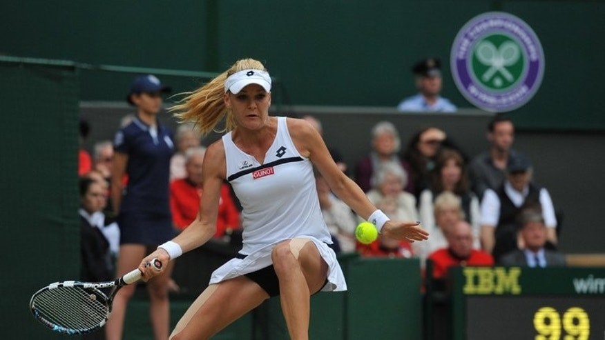 Agnieszka Radwanska returns against Li Na during their Wimbledon women's singles quarter-final match on July 2, 2013. Li was beaten by Radwanska in an epic quarter-final tussle between the highest seeds left standing.