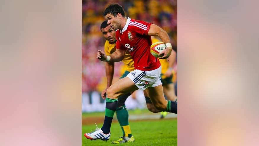 British and Irish Lions player Mike Phillips runs with the ball in the first Test against Australia on June 22, 2013. Scrum-half Phillips is set to return on Saturday after injury.