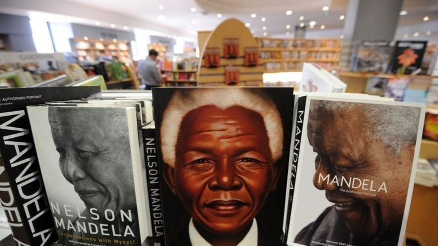 "Picture taken on June 30, 2013 shows books on former South African President Nelson Mandela displayed in a book shop in Johannesburg. Mandela's prolonged illness has sparked intense interest in the anti-apartheid icon's life and times with books, shirts and other ""Madiba merchandise"" flying off the shelves."