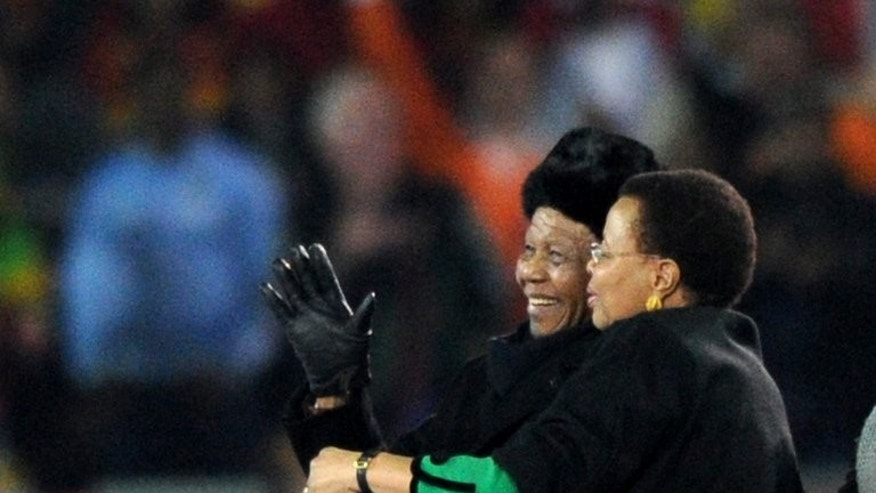 Nelson Mandela and his wife Graca Machel attend the World Cup football final at Soccer City stadium in Soweto on July 11, 2010. The South African national football and rugby union teams will play in a Soweto stadium on August 17 to honour the critically ill former president.