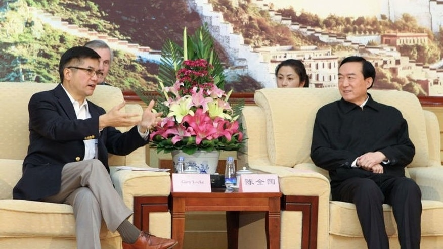 This picture taken on June 27, 2013 and released by the US embassy in Beijing shows US Ambassador to China Gary Locke (L) meeting with Party Secretary of the Tibet Autonomous Region, Chen Quanguo in Lhasa. It was the first time since September 2010 that Chinese authorities had granted a US ambassador access to tightly-controlled Tibet.