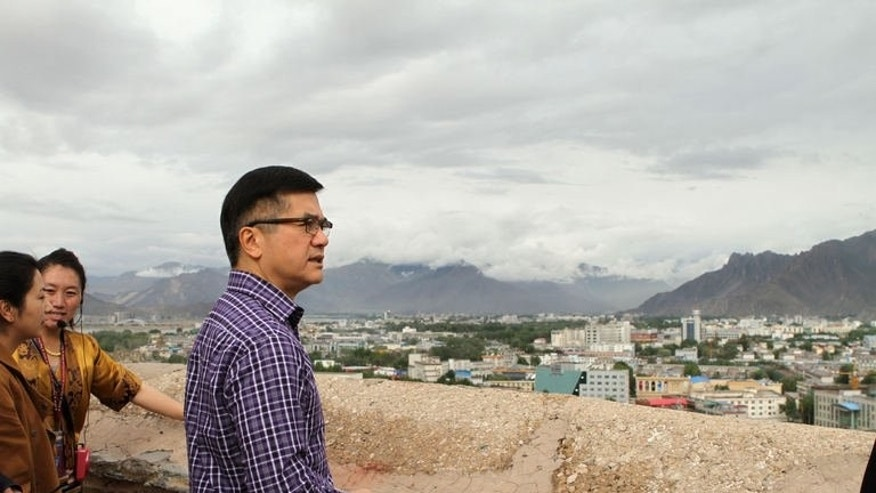 This picture taken on June 26, 2013 and released by the US embassy in Beijing shows US Ambassador to China Gary Locke looking out from Potala Palace in Lhasa, China's Tibet Autonomous Region. Locke urged Chinese authorities to open the area up to tourists and diplomats and highlighted the importance of preserving Tibet's cultural heritage, the State Department said.