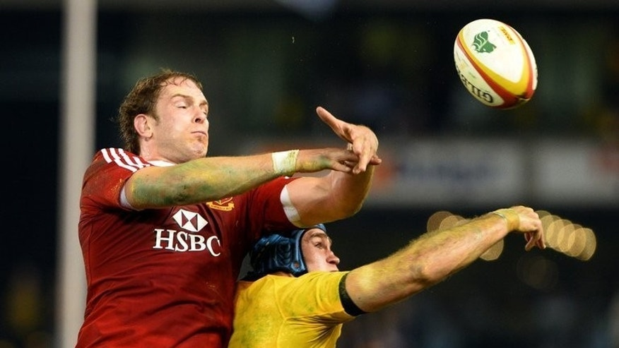 James Horwill (R) and Lions lock Alun Wyn Jones during the second Test in Melbourne on June 29, 2013. Horwill was Tuesday cleared of foul play for allegedly stamping on Jones' head, which would have ruled him out of Saturday's series decider against the Lions.
