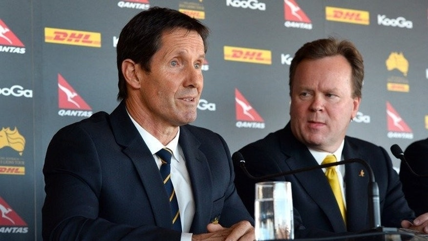 """Australia coach Robbie Deans (L) and Australia Rugby Union chief Bill Pulver at a press conference in Sydney on May 19, 2013. Pulver has described the lengthy period between the initial allegation of stamping and James Horwill's ultimate acquittal as """"unacceptable leading into a Test match""""."""