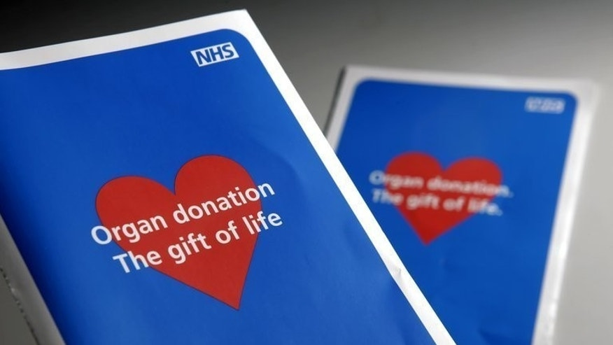 Two organ donor application leaflets pictured London on January 16, 2008. Wales will move a step closer to becoming the first country in the United Kingdom with an organ and tissue donation scheme based on presumed consent if assembly members vote in favour of a bill on Tuesday.