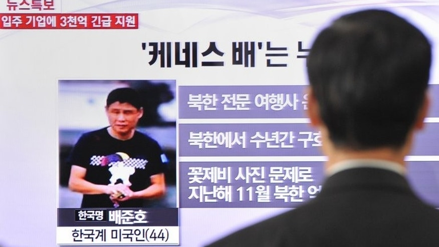 A passerby watches a local television broadcast in Seoul on May 2, 2013 showing a report about Kenneth Bae (left), a Korean-American tour operator detained in North Korea. Bae has appealed to the United States to secure his early release, saying he has been in poor health, according to an interview published Wednesday.
