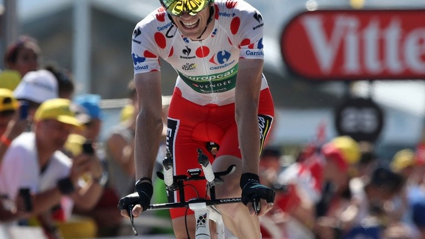 Pierre Rolland crosses the finish line at the end of the Tour de France fourth stage on July 2, 2013. The Frenchman remains in the polka dot jersey as he continues to lead the King of the Mountains competition.