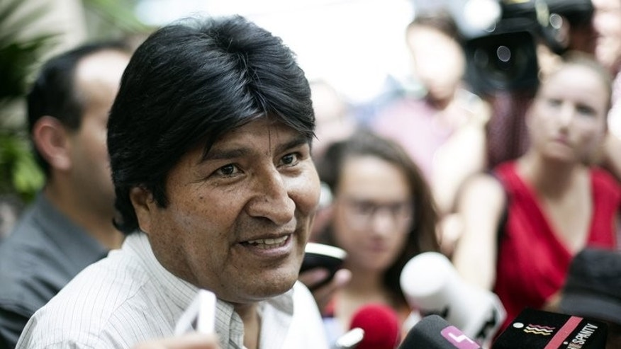 Bolivian President Evo Morales holds a press conference at Vienna International Airport on July 3, 2013. Morales's jet left Vienna on Wednesday after it was diverted overnight on suspicion of harbouring fugitive US intelligence leaker Edward Snowden.