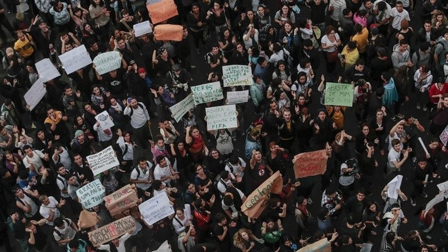 Students protest in Sao Paulo, Brazil on June 17, 2013, against a rise in public bus and subway fares. Brazil's Congress has received a request from President Dilma Rousseff to hold a referendum on political reform in response to the worst social unrest in 20 years.