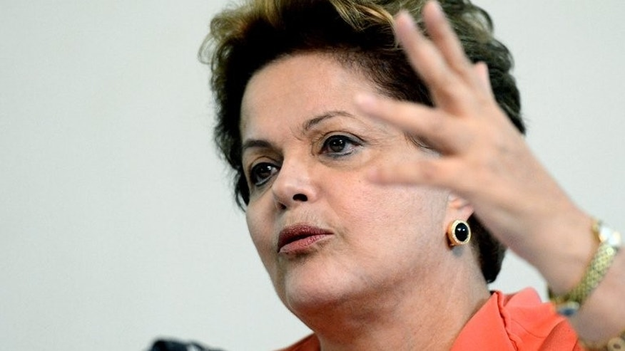 Brazilian President Dilma Rousseff gestures during a press conference at Granja do Torto presidential residence, following a cabinet meeting in Brasilia on July 1, 2013. Brazil's Congress has received a request from President Dilma Rousseff to hold a referendum on political reform in response to the worst social unrest in 20 years.