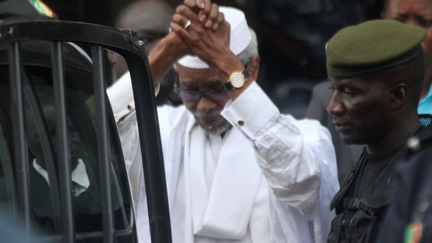 Former Chadian dictator Hissene Habre is escorted by military officers on July 2, 2013 in Dakar. Habre is refusing to recognise a tribunal set up in Senegal to try him for genocide over the deaths of up to 40,000 people during his eight-year rule, his lawyers said on Wednesday.