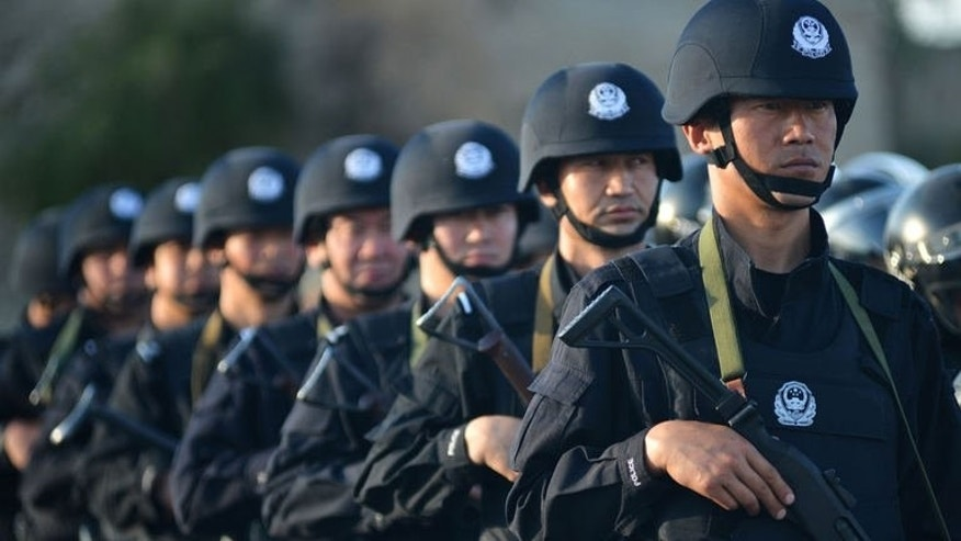 "Anti-terrorism police take part in an exercise in Hami, northwest China's Xinjiang region on July 2, 2013. Authorities in China's restive Xinjiang region have issued a ""most wanted"" list and offered rewards for tipoffs, a government website said Wednesday, continuing the forceful official response to recent unrest ahead of a sensitive anniversary."