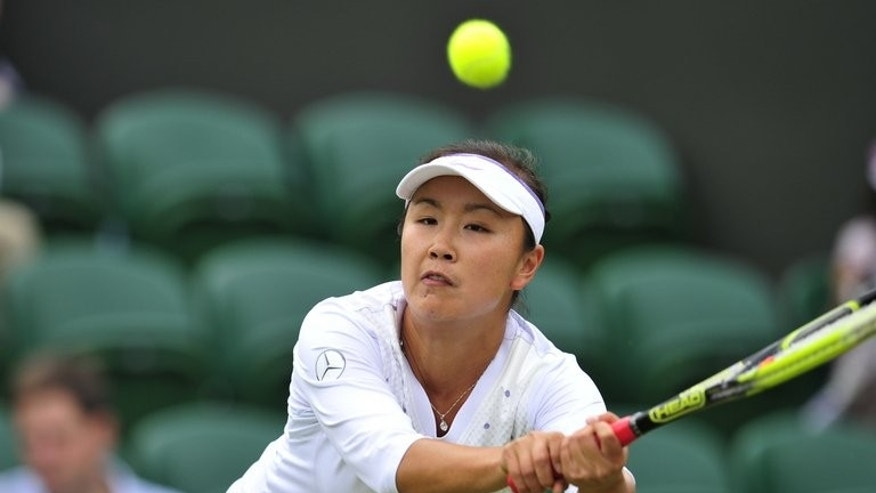 China's Peng Shuai returns the ball to New Zealand's Marina Erakovic at the 2013 Wimbledon Championships, London, on June 27, 2013. Peng and Hsieh Su-Wei of Taiwan have forged a tennis doubles partnership that bridges the divide between the two sides, saying sport can take the heat out of the toughest situations.