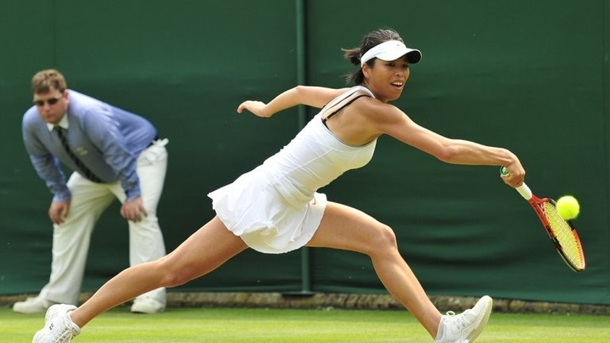 Taiwan's Hsieh Su-Wei leaps to reach the ball during the match against France's Alize Cornet at the 2013 Wimbledon Championships, London, on June 26, 2013. Hsieh and China's Peng Shuai born four days apart in January 1986, have been mates since their junior days and won the first of their five tour titles together back in 2008.