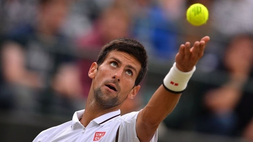 Serbia's Novak Djokovic serves against Czech Republic's Tomas Berdych during their quarter-final match at the Wimbledon Championships in southwest London, on July 3, 2013. Djokovic reached his 13th consecutive Grand Slam semi-final with a 7-6 (7/5), 6-4, 6-3 win over Berdych.