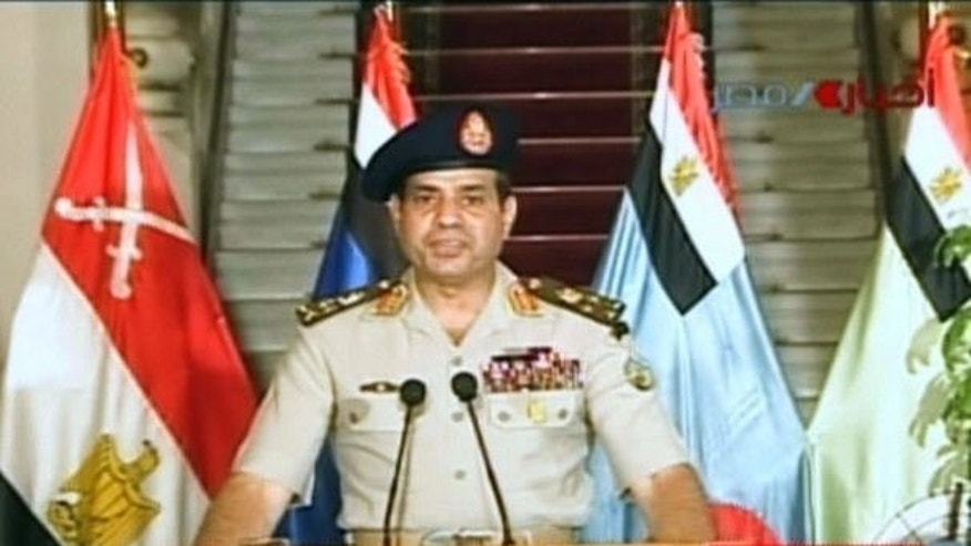 An image grab taken from Egyptian state TV shows Egyptian Defence Minister Abdelfatah al-Sisi delivering a statement on July 3, 2013. Sisi ousted president Mohamed Morsi on Wednesday and declared the head of the Supreme Constitutional Court caretaker leader.
