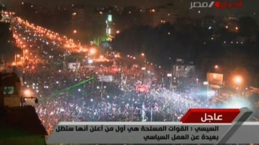 An image grab taken from Egyptian state TV shows opposition supporters celebrating in Cairo after Egyptian Defence Minister Abdelfatah al-Sisi announced on July 3, 2013 the ousting of Islamist President Mohamed Morsi.