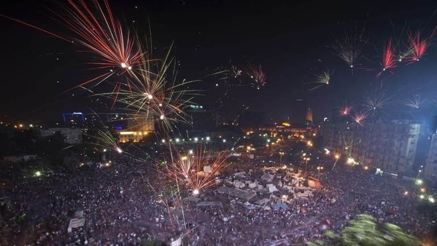 Fireworks light up the sky as hundreds of thousands of Egyptians celebrate in Tahrir square on July 3, 2013 in Cairo. Egypt's army ousted and detained Islamist president Mohamed Morsi on Wednesday after a week of deadly clashes and mass protests calling for him to go after a year in office.