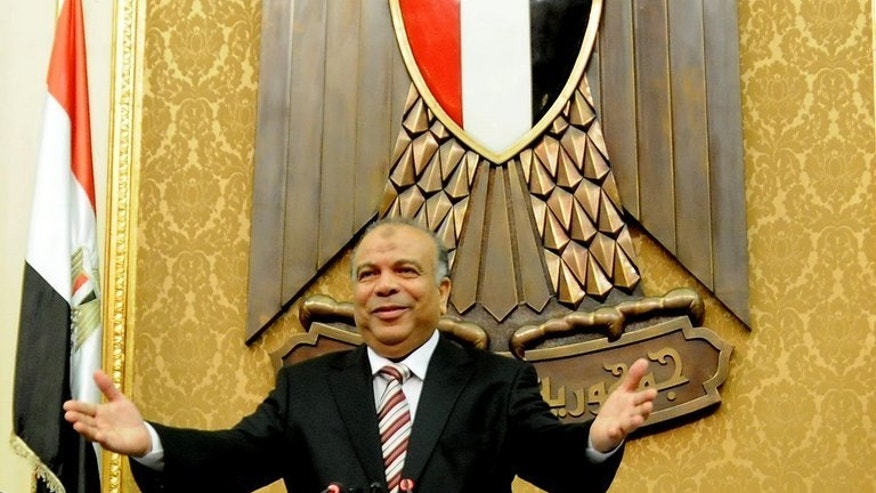 Egyptian Saad al-Katatni attends the first session of the Egyptian parliament in Cairo on July 10, 2012. The Egyptian police have orders to arrest 300 leaders and members of Mohamed Morsi's Muslim Brotherhood after the army deposed the Islamist president on Wednesday, the website of the official Al-Ahram newspaper reported.