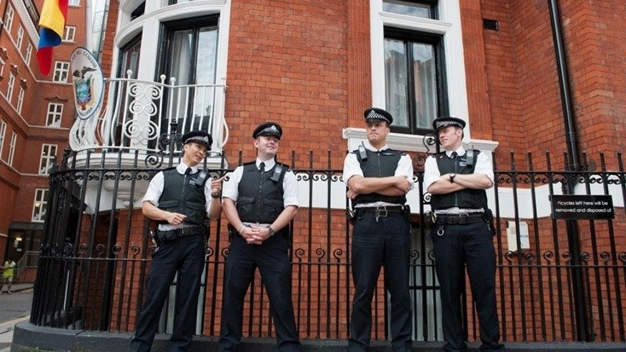 Police stand outside the Ecuadorian Embassy in London on August 19, 2012. A hidden microphone was found in Ecuador's embassy in London, where WikiLeaks founder Julian Assange is holed up, Ecuador's foreign minister said.