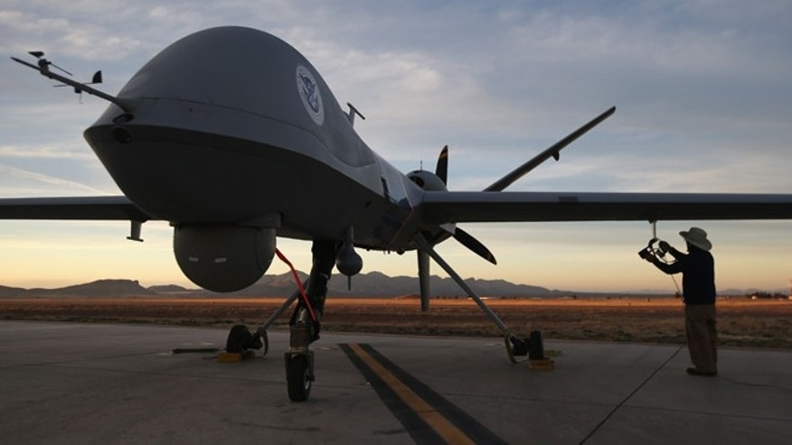 Maintenence personel check a Predator drone operated by U.S. Office of Air and Marine (OAM), before its surveillance flight near the Mexican border on March 7, 2013 from Fort Huachuca in Sierra Vista, Arizona. (Photo by John Moore/Getty Images)