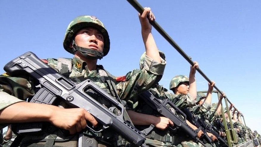 An anti-terrorism forces take part in an exercise in Hami, northwest China's Xinjiang region on July 2, 2013. Xinjiang, a region more than four times the size of Japan, is rich in natural resources and government economic policies aimed at developing it have raised Uighur living standards.