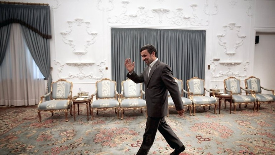 Iranian President Mahmoud Ahmadinejad waves as he arrives for a meeting in Tehran on June 23, 2013. Ahmadinejad on Wednesday defended his government's rights record, saying he was not responsible for other branches of the Islamic regime.