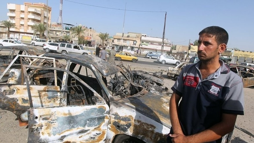An Iraqi man stands at the site of a car bomb explosion in the Hurriyah area of eastern Baghdad on July 3, 2013. A bombing on Baghdad's southern outskirts killed seven people Wednesday, the latest in a three-day wave of bloodshed targeting Shiite Muslims that has left 113 dead amid fears Iraq is slipping back into all-out sectarian war.