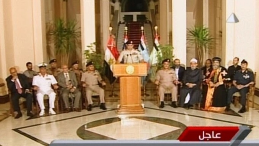 "An image grab taken from Egyptian state TV shows Egyptian Defence Minister Abdelfatah al-Sisi delivering a statement on July 3, 2013 during the unveiling of a roadmap for Egypt's political future. Syrian President Bashar al-Assad said the massive protests against his Islamist Egyptian counterpart brought the fall of ""political Islam,"" in statements posted on Wednesday on his Facebook page."
