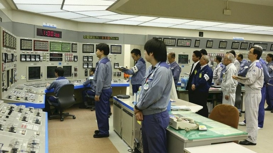 Workers at Oi nuclear power plant stand to attention on July 9, 2012. Japan's nuclear watchdog said the only two reactors currently working in the country -- at Oi -- can stay online for now.