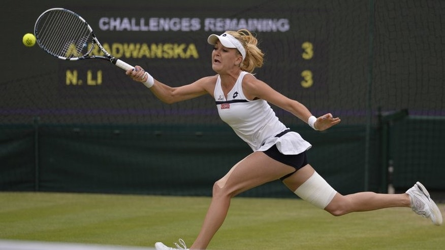 Agnieszka Radwanska returns against Li Na in their Wimbledon quarter-final match on July 2, 2013. She will pose an especially tough test when she faces German Sabine Lisicki on Thursday for a place in the Wimbledon final.